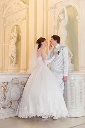 a newly married couple: newlyweds in a beautiful palace Stock Photo