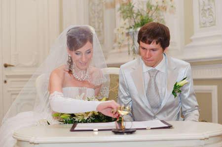 Couple Sign Wedding Register photo