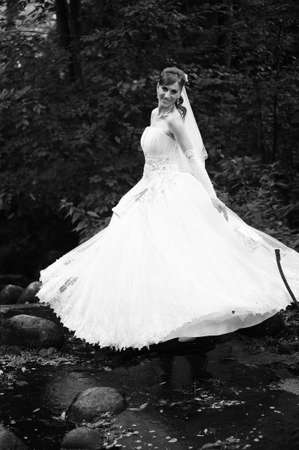 Bride in wedding gown outside photo