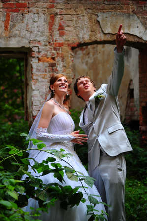 the bride and groom on the ruins photo