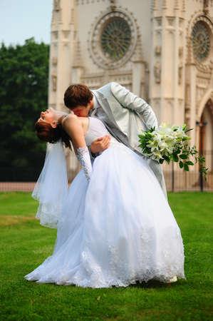 groom embracing his bride photo