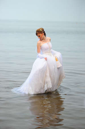 Bride in the water photo