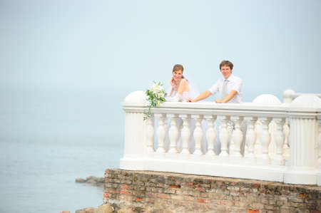 the bride and groom on the terrace by the sea Stock Photo - 8704453