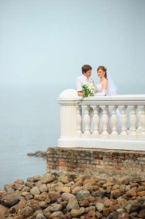 the bride and groom on the terrace by the sea Stock Photo - 8704465