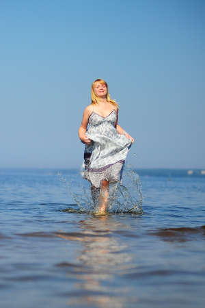 girl in a dress running on water Stock Photo - 8699797