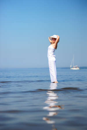 girl in white dress in the sea Stock Photo - 9724513