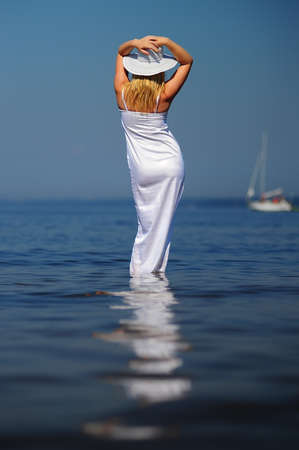 girl in white dress in the sea photo