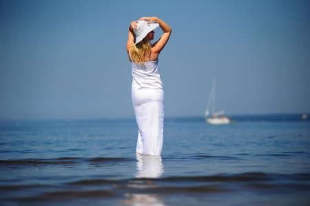 girl in white dress in the sea photo