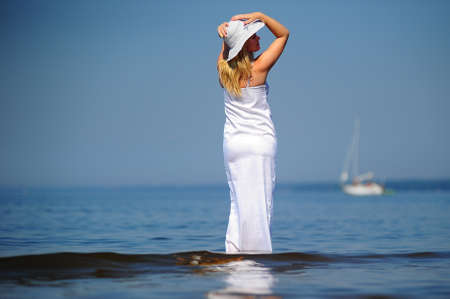 girl in white dress in the sea Stock Photo - 9724511