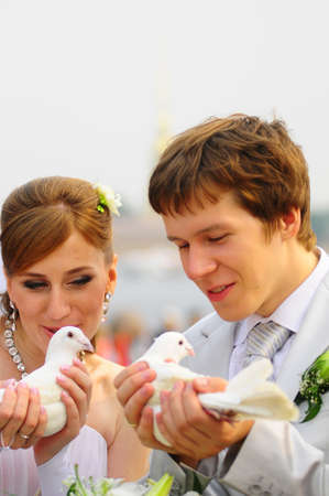 newlyweds with pigeons in hands Stock Photo - 9675753