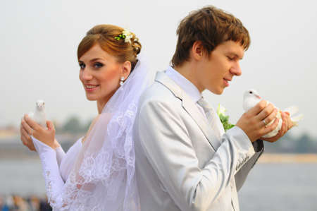 newlyweds with pigeons in hands Stock Photo - 9675751