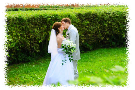 family picture: Bride and Groom kissing Stock Photo