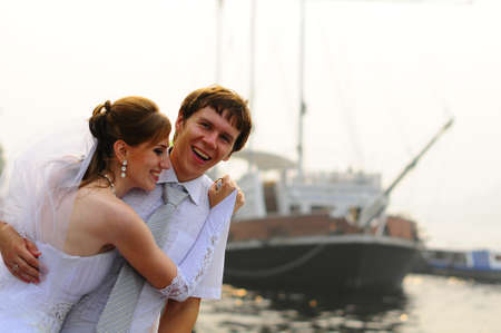 happy bride and groom on the background of the ship Stock Photo - 9725932