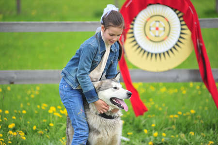 Husky and her owner outdoor photo