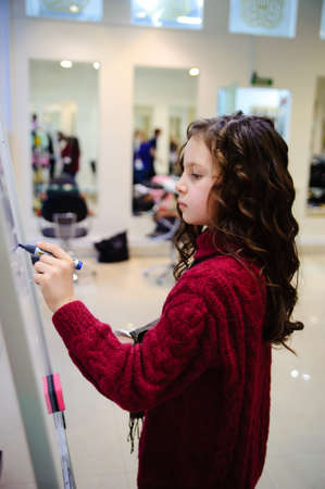 the girl writing on a board photo
