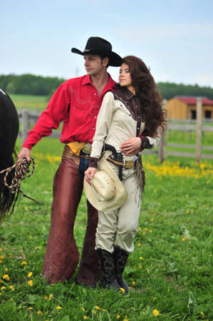 a marriage meeting: cowboy with his wife