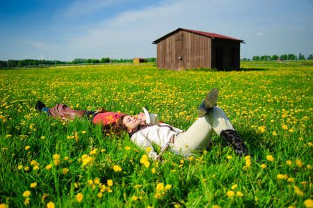 Couple lying together on grass photo