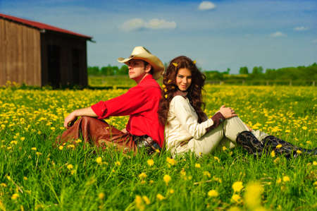 Couple sitting together on grass photo