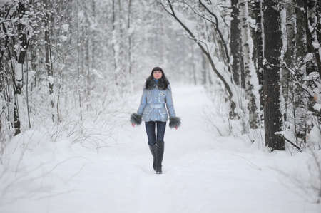 Young beautiful woman  in woodland snow scene Stock Photo