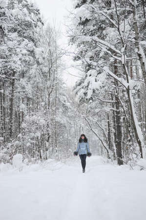 Young beautiful woman  in woodland snow scene Stock Photo - 8560292