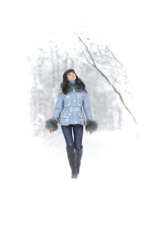 Young beautiful woman  in woodland snow scene Stock Photo - 8560275