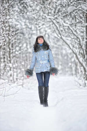 Young beautiful woman  in woodland snow scene Stock Photo - 8560283