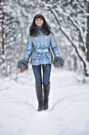 Young beautiful woman  in woodland snow scene Stock Photo - 8560274