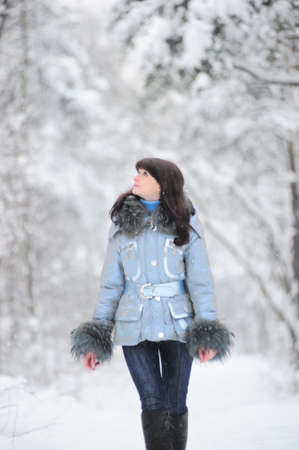 Young beautiful woman  in woodland snow scene Stock Photo - 8560276