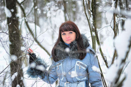 The young woman in winter park Stock Photo - 11976657