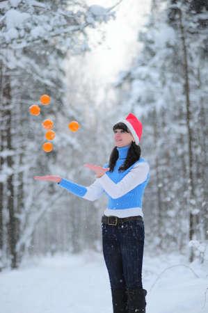 girl juggling oranges photo