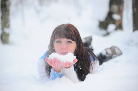 young woman lying in the snow photo