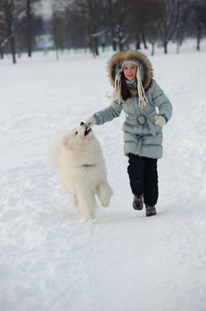 Running with dog at winter time Stock Photo - 8678965