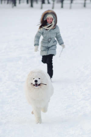 Running with dog at winter time photo