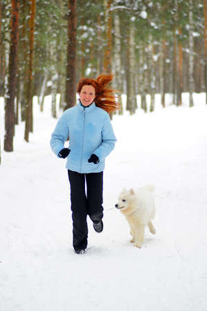 Girl with a puppy Samoyed  photo