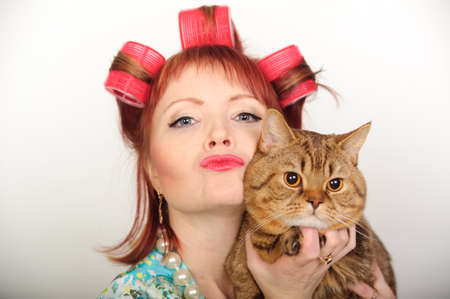 Portrait of a housewife with a cat Stock Photo - 8612064