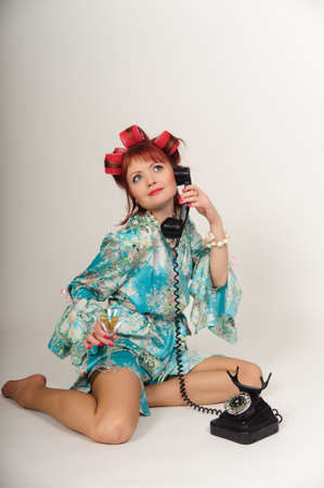 sexy housewife speaking on the phone Stock Photo - 8678324