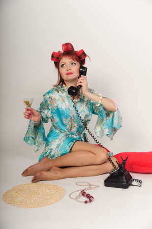 sexy housewife speaking on the phone Stock Photo - 8678382