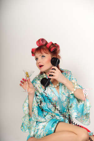 sexy housewife speaking on the phone Stock Photo - 8678388