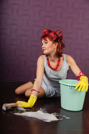 Sexy housewife is cleaning the floor Stock Photo - 8678240
