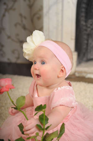 keep an eye on: Baby with a rose