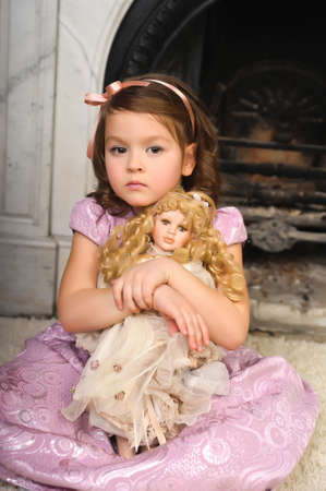 little girl with a doll in  hands. Photos in retro style Stock Photo - 8677990