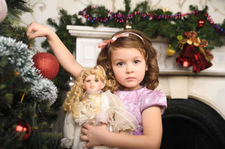 little girl with a doll in  hands. Photos in retro style Stock Photo - 8677995