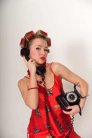 Girl in Pin up pose & Fashion talking on the phone Stock Photo - 8645828