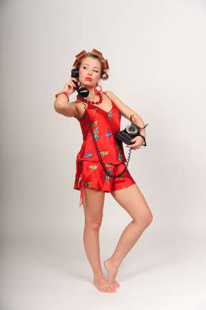Girl in Pin up pose & Fashion talking on the phone Stock Photo - 8645813
