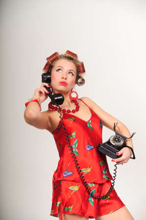 Girl in Pin up pose & Fashion talking on the phone Stock Photo - 8645825