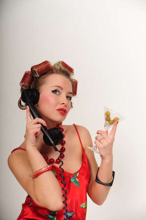 Girl in Pin up pose & Fashion talking on the phone Stock Photo - 8645823