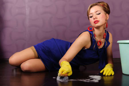 cleaning woman: Sexy housewife is cleaning the floor Stock Photo