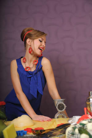 girl with a meat grinder photo