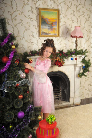 Girl decorating Christmas tree retro photo