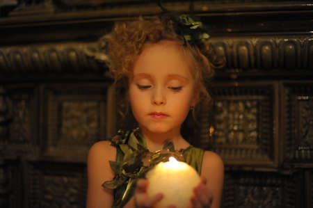 Young beautiful, girl portrait by glow of candlelight Stock Photo - 8716071